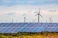 Solar And Wind Power In Coastal Mud Flat Royalty Free Stock Photo - 33516895
