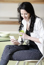 Woman Chatting On Her Mobile Phone Royalty Free Stock Photos - 33521798