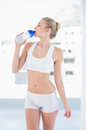 Attractive Young Blonde Model Drinking Water In A Bottle Royalty Free Stock Images - 33526549