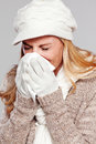 Woman Holding A Handkerchief And Blowing Her Nose Royalty Free Stock Image - 33531416