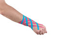 Tex Tape Therapeutic Treatment  Of The Wrist. Royalty Free Stock Photography - 33536437