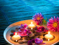 Dish Spa With Floating Candles, Daisys, Orchid On Mat Stock Image - 33591491
