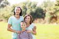 Portrait Of Adult Couple With Teenage Son Royalty Free Stock Photos - 33613388