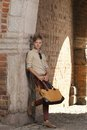 Young Man With Bag On Street, Old Town Gdansk Stock Photography - 33632382