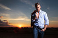 Casual Man With Hand In Pocket At Sunset Royalty Free Stock Photo - 33659125