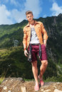 Casual Man In The Mountains With Hand In Pocket Stock Photos - 33659303