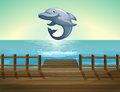 A Jumping Dolphin And Sea Port Royalty Free Stock Photos - 33695108