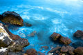 Rocks And Blue Sea Royalty Free Stock Photo - 3372225