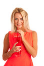 Beautiful Young Woman In Red Dress With A Glass Of Ice Tea Royalty Free Stock Image - 33796956