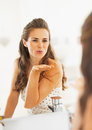 Happy Young Woman Blowing Air Kiss In Mirror In Bathroom Royalty Free Stock Photo - 33812595