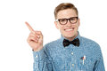Smiling Nerd Pointing Away Royalty Free Stock Photography - 33859847