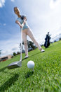 Woman Playing Golf Royalty Free Stock Image - 33871176