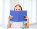 Girl Studying And Reading Book At School Royalty Free Stock Image - 33874366