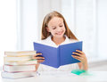 Girl Studying And Reading Book At School Royalty Free Stock Images - 33874399