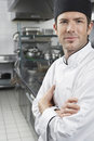 Chef With Arms Crossed In Kitchen Royalty Free Stock Photography - 33887457