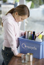 Girl Putting Empty Vessels Into Recycling Container Stock Photos - 33890933