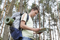 Side View Of Young Man With Backpack Reading Map In Woods Stock Images - 33908714