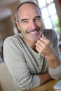 Portrait Of An Happy Man Sitting At Home Stock Image - 33917511