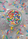 Multi-colored Pastry Decoration In A Glass Jar Stock Photography - 33918682