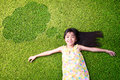 Little Asian Girl Resting On Green Grass Royalty Free Stock Image - 33930316