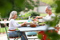 Couple Sitting At Table For Lunch On Terrace Royalty Free Stock Image - 33934906