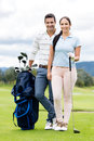 Couple Playing Golf Royalty Free Stock Photos - 33941198