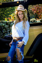 Beautiful Blonde Model In A Straw Cowboy Hat. Royalty Free Stock Image - 33955816