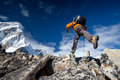 Hiker Jumps On The Rock Near Everest In Nepal Stock Photography - 33963572