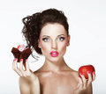 Dilemma. Diet. Undecided Woman With Apple And Cupcake Stock Photo - 33963780