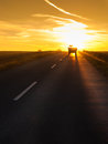 Truck Traveling At Sunset Stock Photo - 33974320