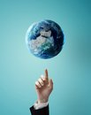 Hand Pointing At Earth Royalty Free Stock Photos - 34013128