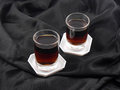 Two Glasses With Wine On Black Material Background Royalty Free Stock Images - 34026439