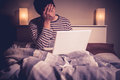 Sad Man In Bed With Laptop Stock Photos - 34033283