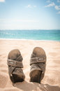 Sandals In The Sand Of A Tropical Beach Royalty Free Stock Photos - 34035698