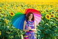 Smiling Girl In The Sunflower Fields Royalty Free Stock Photos - 34059058