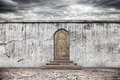 Wall With Door On Dry Earth Royalty Free Stock Photo - 34060525
