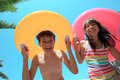 Children With Inflatable Tubes Stock Image - 34060561