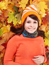 Young Woman In Autumn Orange Leaves. Stock Photography - 34068332