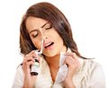 Young Woman Using Throat Spray. Royalty Free Stock Image - 34069246
