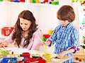 Family With Child Playing Bricks. Stock Images - 34069614