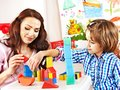 Family With Child Playing Bricks. Royalty Free Stock Image - 34069626
