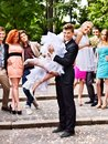 Groom Carries His Bride Over Shoulder. Royalty Free Stock Photo - 34069795