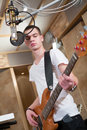 Young Bass Player Standing With His Guitar Stock Photography - 34070572