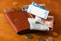 Wallet And Some Money On A Woden Table Stock Photo - 34075410