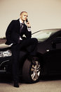 Young Businessman Calling On Cell Phone By Car Stock Image - 34082751