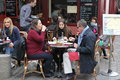 View Of Typical Paris Cafe On May 1, 2013 In Pari Royalty Free Stock Images - 34102749