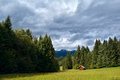 Little Hut On Meadow In Coniferous Alpine Forest Royalty Free Stock Photos - 34103228