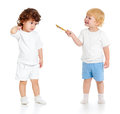 Baby Boy With Paint Brush And Girl Standing Full Length Isolated Royalty Free Stock Photography - 34128727