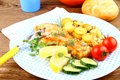 Fried Fish Fillet With Rosemary Potatoes And Vegetables Stock Images - 34139814