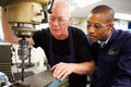 Engineer Teaching Apprentice To Use Milling Machine Royalty Free Stock Image - 34158756
